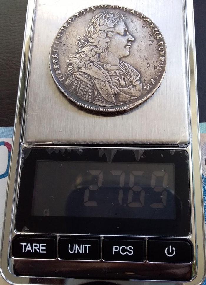 Монета на электронных весах